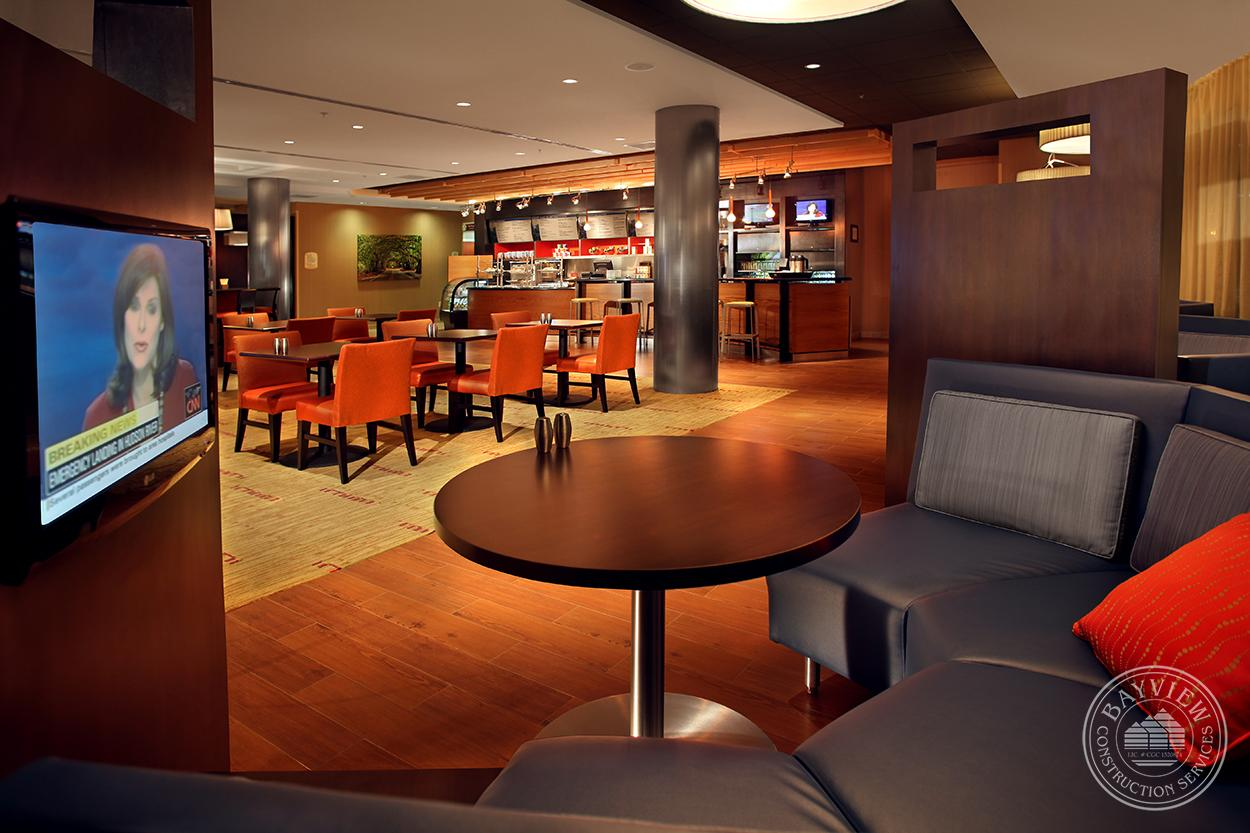 Courtyard by Marriott bar/dining booth with tv