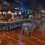 Game room and bar of Charlie's Neighborhood Bar & Grill Stuart, FL